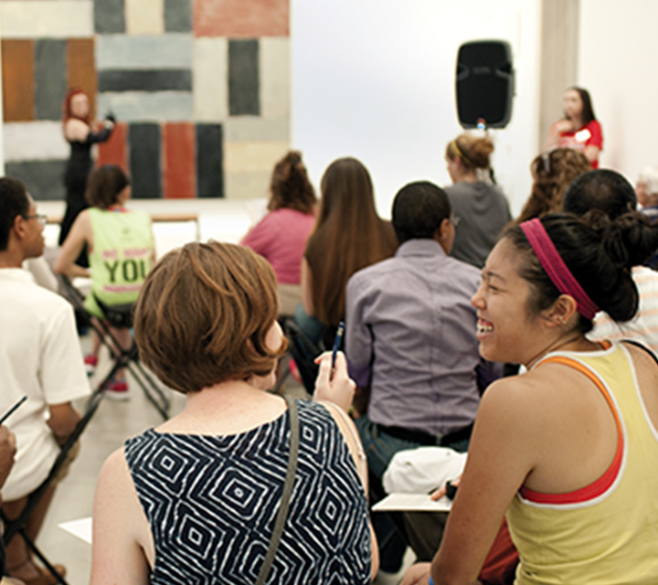 Visitors enjoy a public program in the galleries