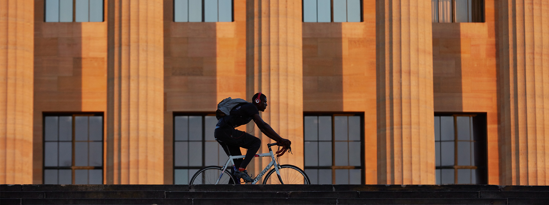 Biker riding in front of the museum