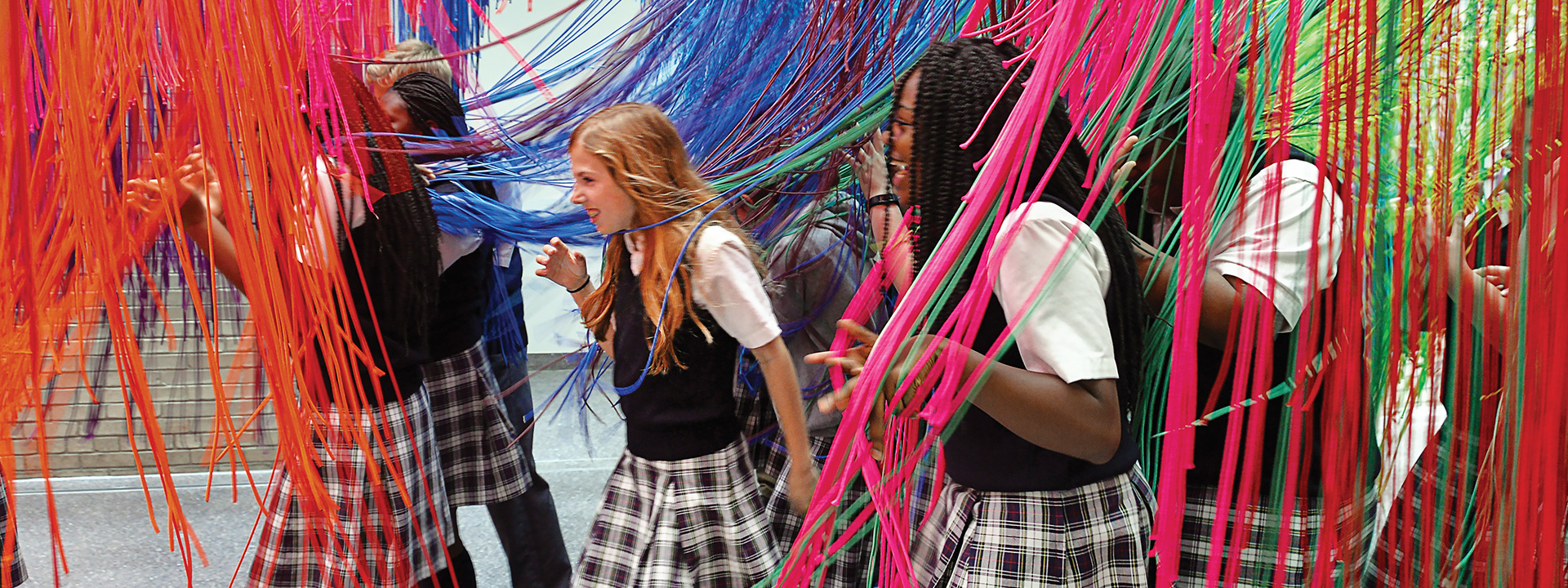 School group interacting with an art installation