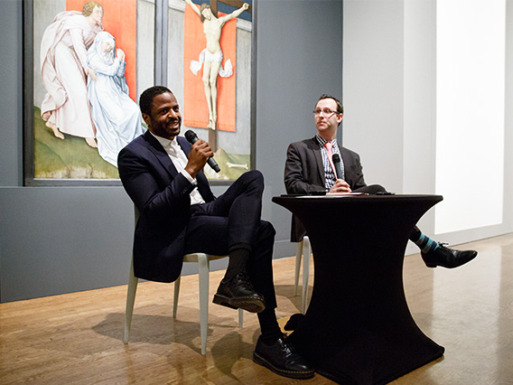 Artist Jas Knight in discussion with a museum staffer in the galleries