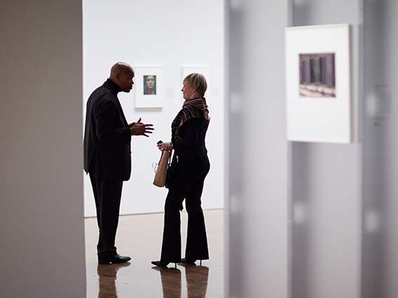 Two visitors conversing in the galleries