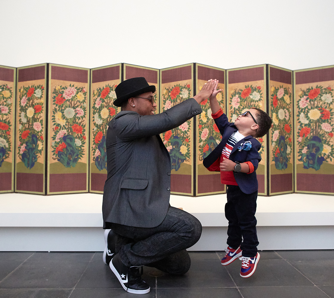 Two visitors exploring the galleries