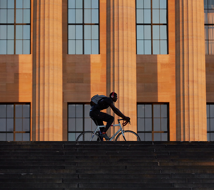 Biker riding in front of the main building