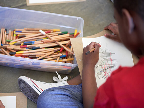 Close-up of a child drawing on a piece of paper